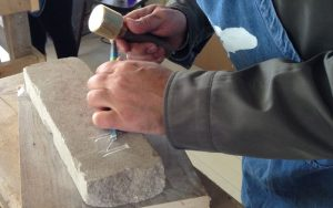 dsc-cu-of-stone-carving-workshop-participant-at-work